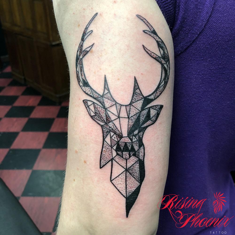 aztec buck rising phoenix tattoo